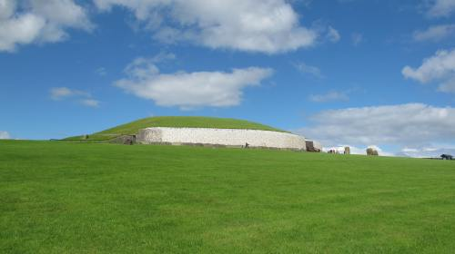 Newgrange Neolithic site dating from around 3200 BCE, Co Meath, Eire. It is aligned with the rising sun, which floods the interior stone chamber with light at dawn on the winter solstice. The inner passageway and end chamber is set out in the shape of a classical Celtic Cross, also depicting the six directions of space.